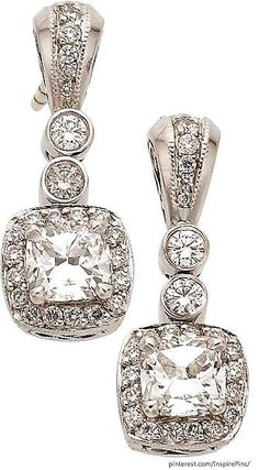 Michael Beaudry Diamond, Platinum Earrings Platinum with approximately 1.50 carats total weight of diamonds.