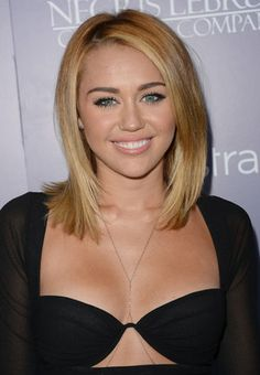 Cyrus with longer locks in 2012. (Getty Images)