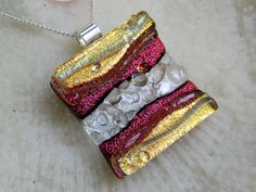 Dichroic red and gold fused glass texture pendant