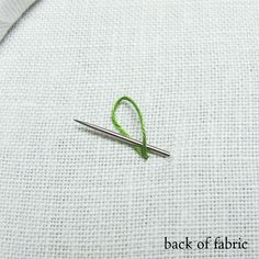 No knot- one doubled over thread embroidery! take the needle down into the fabric and inside the loop left on the back