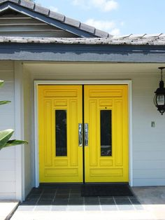 This bold front door from designer Nathan Fischer creates a striking contrast with the neutral home exterior.