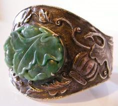 Amazing repousse...and look at that jade.