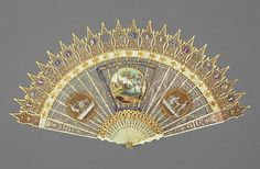 Ivory brisé fan, painted and gilded in the Gothic Revival style, French c1800-1820. Fitzwilliam Museum