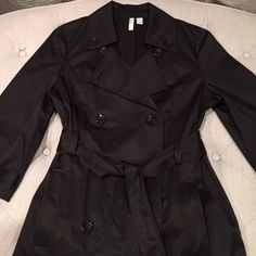 NWOT Old Navy trench coat NWOT Old Navy trench coat. This has never been worn and is in pristine brand new condition. Sleeves are 3/4 and has pockets. An excellent jacket for the spring...very classy. Price firm unless bundled. Old Navy Jackets & Coats Trench Coats