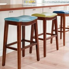 Subtly contoured, the Julien Bar Stool has a comfortable upholstered seat articulated with brushed-nickel nailhead accents and         covered with durable bonded leather.                           Solid-wood frame                                Espresso finish                              Brushed-nickel accents          Bonded leather is easy to care for; view instructions