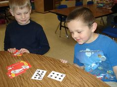 Compare the numbers. The one with the highest number keeps the card. The student with the most cards wins.