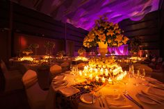 mystical, dimly lit, lighting, cande lit, large tree centerpieces, reception, dark, elegant, glamorous decor