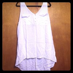 Torrid White Challis Tank This is a basic staple for everyone's closet! It's a white challis tank top featuring two pockets on the front. Size 3 (22/24) Fabric: Rayon torrid Tops Tank Tops