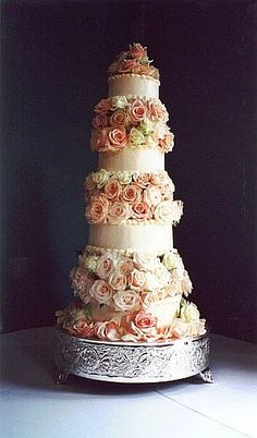 Beautiful, four tier, smooth   design with Italian Buttercream Icing