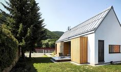 This pitched roof house replaces old brick buildings and wooden barns in Slovakia.