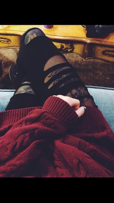 Red sweater + ripped black jeans. <3