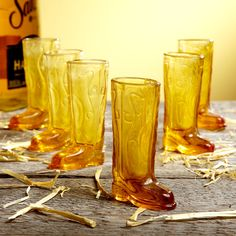 Cowboy up, partner, with our 6-piece shot glasses set! This unique set of shot glasses are made of amber-colored glass and will have your friends shaking in their boots as they rustle up some tequila and limes and throw back a shot or two! It's a funny shot glass perfect for the cowboy lovin' rough and tumble night out. Each glass shooter in this cowboy up shot glasses set measures 3   tall and holds 1   ounces.