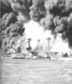 U.S.S. West Virginia and U.S.S. Tennessee burn after Japan's attack on Pearl Harbor, December 7, 1941.