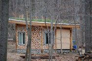 One-room cabin in West Virginia built with reclaimed materials from Community Forklift.