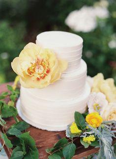 yellow flower adorned wedding cake