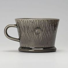 This is a thrown earthenware mug, in an 'inkwash' glaze, by Walter Keeler.