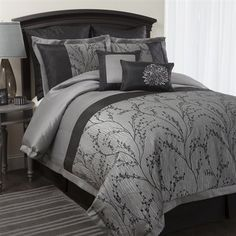 "Flower Texture 8-Pc Comforter Set This jacquard and brushed poly fabric features hand construction with piercing and pin tucking. The gray background and detailing of the black branches create a design that will help to make your bedroom feel like it is part of a garden scene. Warm and striking, this 8 pc. set will become the centerpiece of any room where it is placed.  Queen Set Includes:  (1) Comforter (92"" L x 90"" W) (1) Bed skirt (2) Euro shams (2) Pillow shams (2) Decorative pillows…"