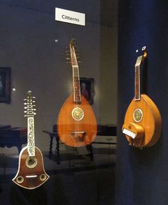 """Various """"citterns.""""  The bell version is spectacular, several were built by Joachim Tielke (1641-1719).  The others are two classic """"English guitars"""" (tuned to open C), properly spelled English guittar.  Not one, but three papers addressed this instrument (much new to me – thanks to Panagiotis Poulopoulos, Daniel Wheeldon and James Westbrook for the their research)."""