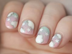 i redid that really old pastel sky mani from ages ago now it looks much nicer n__n
