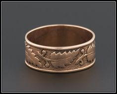 A wonderful antique cigar band (circa 1880-1900) with a deeply chased leaf design. This rose gold ring is unmarked, but acid tests for 14k gold. The interior of the band is engraved A.C. to M.L. and the condition is quite good with minimal wear to the design.  The ring is a size 6.5, but can be re-sized up or down slightly without damage to the ring because of a slight space in the original design. We offer re-sizing services free of charge, so please contact us if you are interested in our…