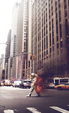 NYC. While you wear an astronaut dress with your back on fire you are permitted to cross 6th Avenue out of the crosswalk... //  by GRAPHICS DESIGNED, via Flickr