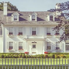White house, white shutters, white planters.. gray roof... Very pretty....white classic exterior  simply seleta