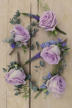 Beautiful Lilac Ocean Song Rose Buttonholes with Blue Muscari & Hyacinth accents.....perfect for a Spring Wedding www.weddingandevents.co.uk North Yorkshire Wedding Flowers