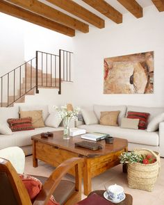 Masia- I love the beams. All of this wood floats against the neutral, creamy white background. . Very soothing