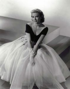 """GRACE KELLY in black & white gown for the Hitchcock thriller """"Rear Window"""" (1954) designed by Academy Award winning costumer designer EDITH HEAD."""