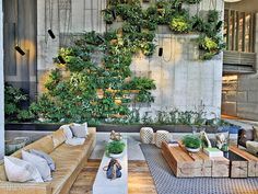 At 1 Hotel Brooklyn Bridge Park by INC Architecture & Design, the lobby's plant wall features ferns and vines. Photography by Eric Laignel. Hotel Lounge, Casa Hotel, Lobby Lounge, Hotels In Bangkok, Downtown Hotels, Honolulu Hotels, Barcelona Hotels, Florida Hotels, Hotel Lobby Design