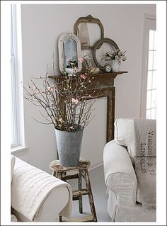 Antique accessories, dried flowers, and austere simplicity are a beautiful way of capturing a certain country style. #country #livingroom