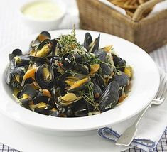 Moules frites fresh mussels, (see try below) 3 large spring onions 1 large shallot, peeled and halved 1 carrot, peeled and halved lengthways 2 fat garlic cloves, peeled 1 fresh red chilli 1 bunch thyme handful flat-leaf parsley olive oil about Gordon Ramsey, Moules Frites Recipe, Bbc Good Food Recipes, Mussels, Fish And Seafood, Seafood Recipes, Seafood Dishes, Dinner Recipes, Salads