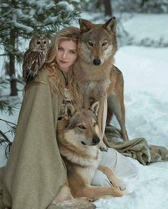 I would love to be sitting on the snow surrounded by a cheetah a wolf some birds, an amazing shot