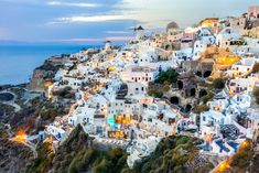 Santorini island at sunset, viewpoint from Oia village, Santorini, Greece. Most beautiful place in Greece