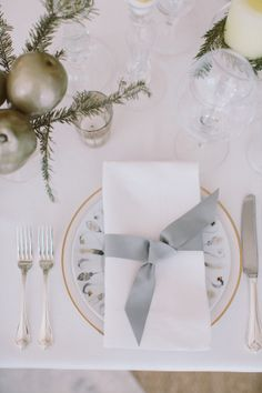 tying a piece of ribbon around a napkin -  easy and elegant