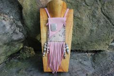 "Lovely Pink Deer Leather Medicine Bag with Boa Snake Skin and Fossilized Coral Bag Dimensions 3"" x 4"" with tassels 7"" Necklace Length: 24"" Gemstone and Animal Spirit Meanings: *Fossilized Coral: Recon"