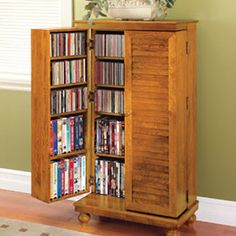 """Compact cabinet stores over 600 CDs! This attractive Mission-style cabinet fits in a small space, yet offers storage for 612 CDs, 298 DVDs or 172 VHS tapes! Made of solid oak, it fits in a space less than 24"""" wide and blends with most decors."""