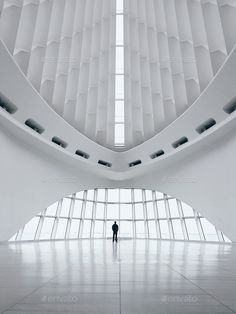 a man silhouette in huge architectural space