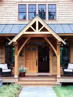 cedar beams; entrance and low front porch