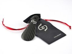 A mini shoehorn made 100% out of real carbon fiber, ideally suited for business trips or simply keeping in your pocket or handbag.  $180    http://store.carbonfibergear.com/caladorf-traveler-carbon-fiber-shoehorn