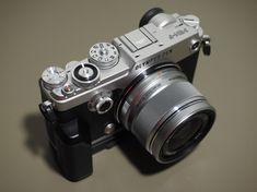 Olympus Pen F + 25mm f1.8 lens in silver