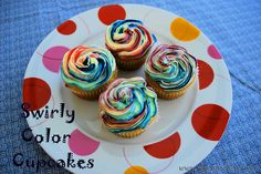 Swirly color cupcakes...made these and they turned out great. I used the Wilton colors, used the back of spoon to line the bag. :)