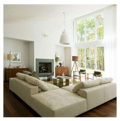 Warm yet modern living room by Adam Rolston