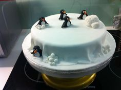 Cute penguins in the snow Christmas cake