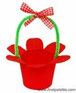 Paper cup flower basket--This might be a cute party favor/party decoration--fill with candy