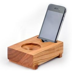 """Koostik Mini Koo iPhone Speaker. It makes use of natural passive amplification through its """"trumpet horn"""" speaker port, and requires no power to operate. Available in solid walnut and cherry."""