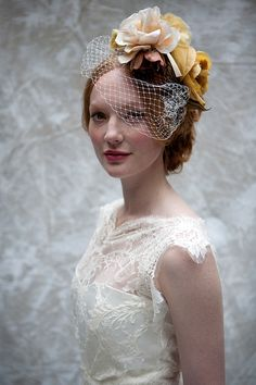 Sally Lacock ~ Vintage Inpsired Wedding Dresses For The Modern Day Bride. http://www.sallylacock.com/  www.cherishedvintage.co.uk headpiece and birdcage veil