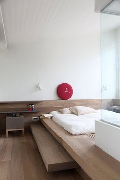 Crisp contemporary lines are warmed by wood and an earthy colour palette. Shots of colour are u...