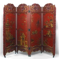 19th/20th century Chinese style red and gold lacquered four fold screen featuring a carved floral frame and a Chinoiserie design.
