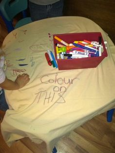 An old bed sheet on the table with washable markers=Genius!! Great for group activity and you can wash/rewash one thousand times.  Better for the environment( no paper wasted) And if the children are really attached to keeping that art work, take a photo for goodness sakes..... Or hit up your local thrift shop to buy a new sheet.  We used a flat sheet because that is what I had on hand, but how great would a fitted sheet be to wrap around your table top??!!! Just make sure to have something underneath as the markers do bleed through.  Yikes!!  Good thing its the kids art table....( and again, the markers are in fact washable).